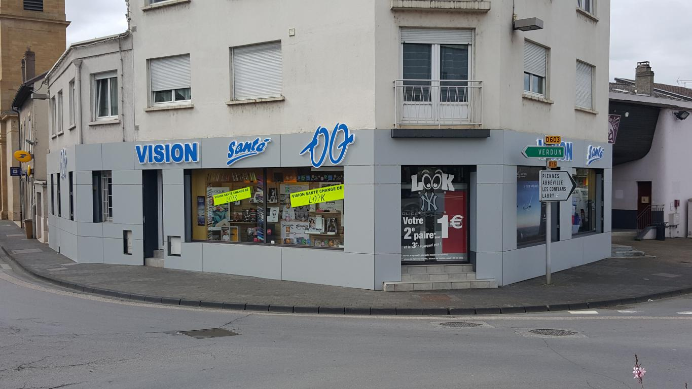 FHabillage de façade en Trespa magasin optique VISION SANTE
