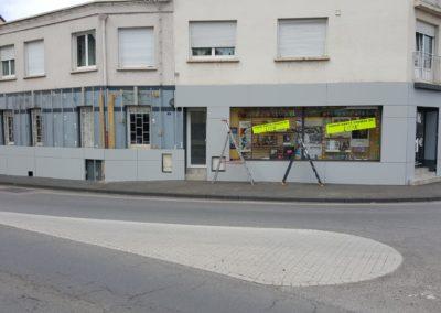 Habillage de façade en Trespa magasin optique VISION SANTE